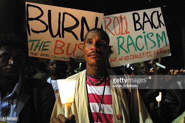 Delegates at the World Conference Against Racism hold a candle-light vigil at the International Conference Centre in Durban 05 September 2001,...