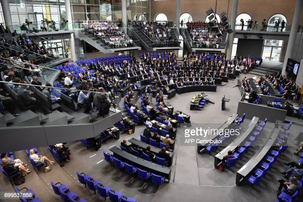 Delegates attend a commemoration ceremony for late former German Chancellor Helmut Kohl at the plenary hall of the German Bundestag in Berlin on June...
