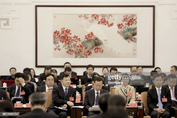 Delegates attend a meeting at the Great Hall of the People during the 19th National Congress of the Communist Party of China in Beijing, China, on...