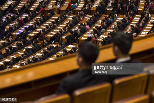 Delegates attend a session during the first session of the 13th National People's Congress at the Great Hall of the People in Beijing China on...