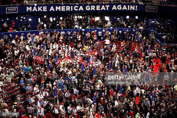 Delegates attend roll call on the second day of the Republican National Convention on July 19 2016 at the Quicken Loans Arena in Cleveland Ohio...