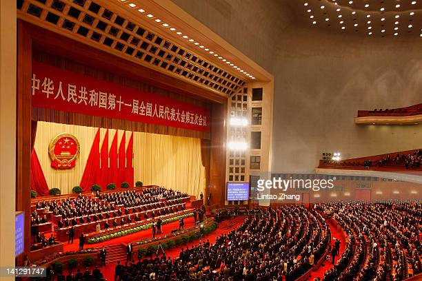Delegates attend the closing ceremony of the closing session of the National Peoples Congress at The Great Hall Of The People on March 14 2012 in...