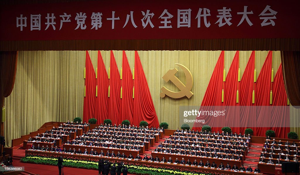 Delegates attend the closing session of the 18th National Congress of the Communist Party of China at the Great Hall of the People in Beijing, China, on Wednesday, Nov. 14, 2012. Vice President Xi Jinping and Vice Premier Li Keqiang were reappointed to the Chinese Communist Party's Central Committee, positioning them to take over the top two posts in the world's second-biggest economy. Photographer: Tomohiro Ohsumi/Bloomberg via Getty Images
