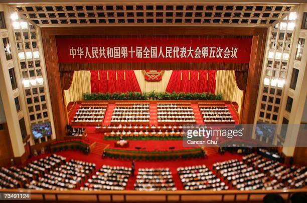 Delegates attend the opening of the National Peoples Congress in the Great Hall of the People on March 5 2007 in Beijing China