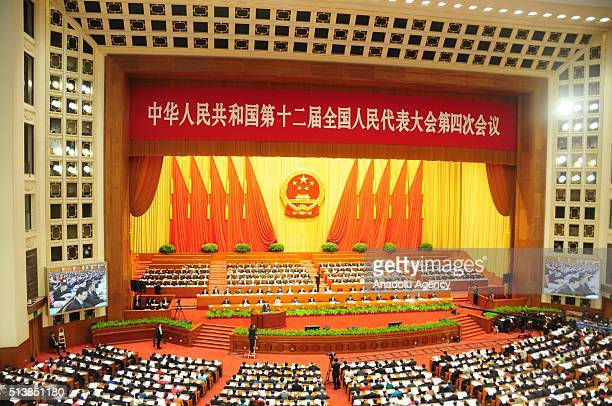 Delegates attend the opening session of the 12th National People's Congress kicks off at the Great Hall of the People in Beijing China on March 5 2016