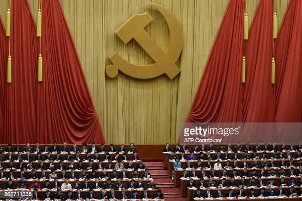 Delegates attend the opening session of the Chinese Communist Party's five-yearly Congress at the Great Hall of the People in Beijing on October 18,...