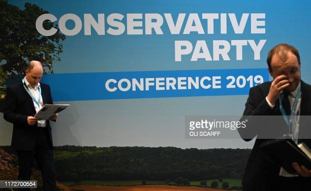 Delegates attend the third day of the annual Conservative Party conference at the Manchester Central convention complex in Manchester northwest...