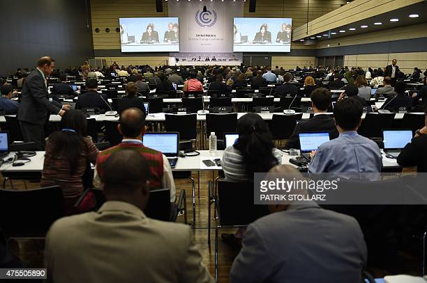 Delegates attend the United Nations Framework Convention on Climate Change in Bonn western Germany on June 1 2015 The convention takes place at the...