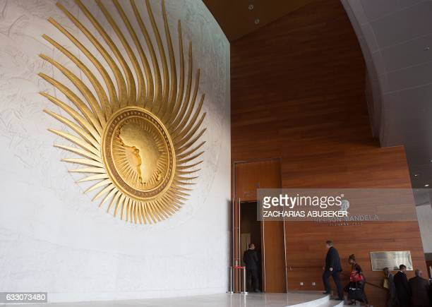 Delegates attending the 28th African Union Heads of State Summit walk into the main plenary hall at the AU hearquarters prior to the opening ceremony...