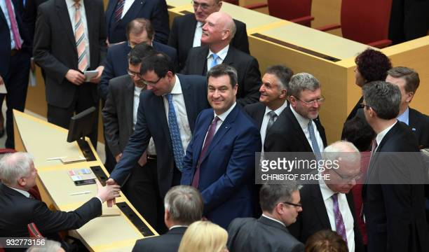 Delegates bid farewell to Horst Seehofer as Bavaria's newly elected State Premier Markus Soeder looks on during a session of the Bavarian parliament...