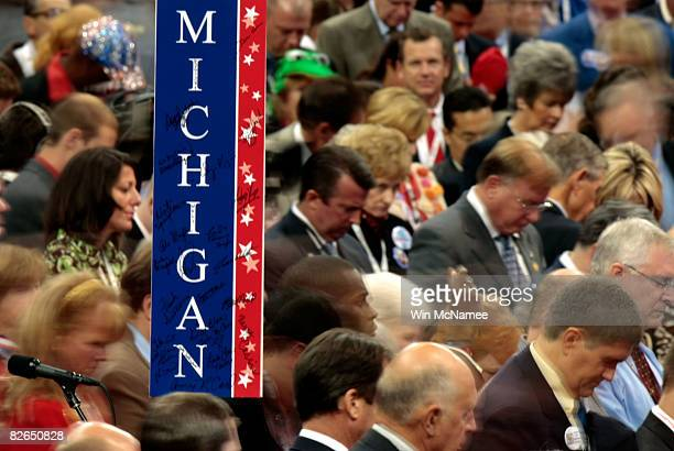 Delegates bow their heads on the floor on day three of the Republican National Convention at the Xcel Energy Center on September 3 2008 in St Paul...