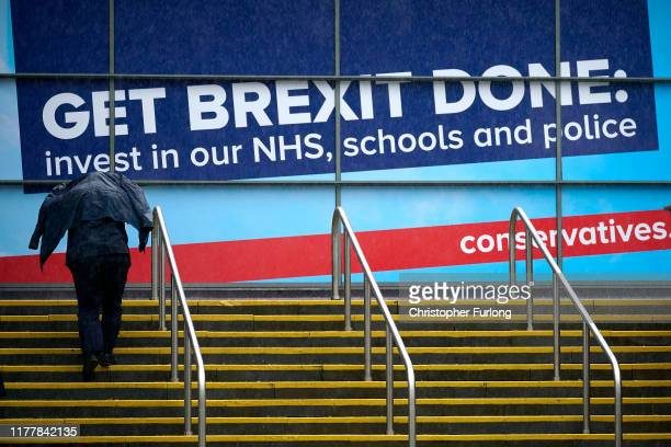 Delegates brave a downpour on the first day of Conservative Party Conference at Manchester Central on September 29, 2019 in Manchester, England....