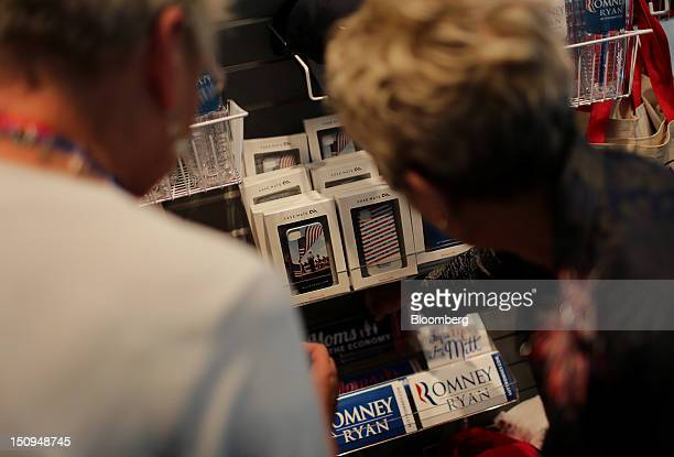 Delegates browse the RomneyRyan official store at the Republican National Convention in Tampa Florida US on Wednesday Aug 29 2012 Representative Paul...