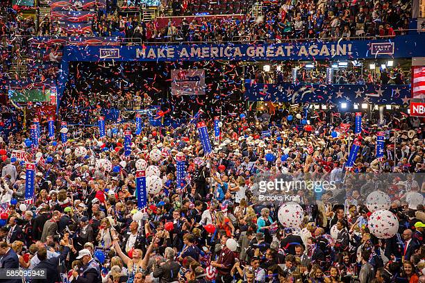 Delegates celebrate admits the confetti after Republican nominee Donald Trump speaks after the Republican Convention July 21 2016 in Cleveland Ohio
