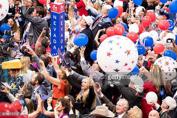 Delegates celebrate as balloons drop from the rafters after Donald Trump accepted the GOP nomination to be President of the United States at the 2016...