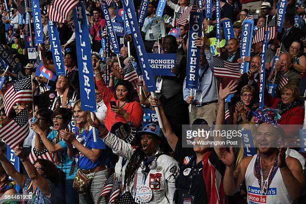 Delegates celebrate as Democratic Presidential Nominee Hillary Clinton addresses the Democratic National Convention in Philadelphia on Thursday July...