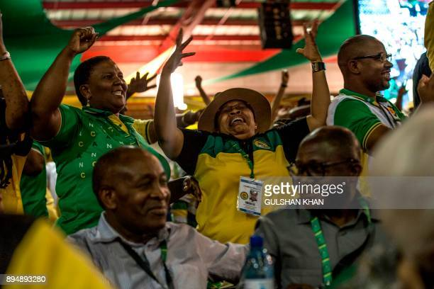 Delegates celebrate results at the NASREC Expo Centre in Johannesburg on December 18 during the African National Congress 54th National Conference...