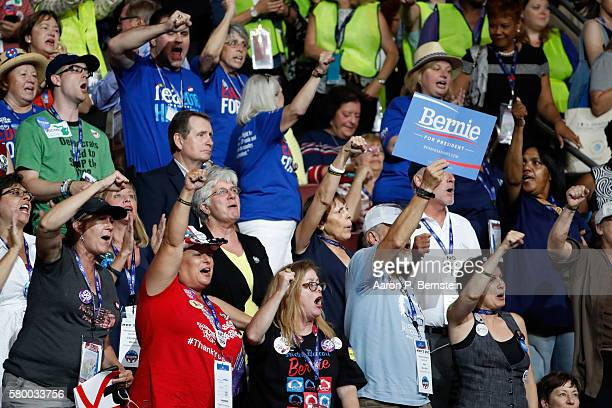 Delegates chant Bernie during the first day of the Democratic National Convention at the Wells Fargo Center July 25 2016 in Philadelphia Pennsylvania...