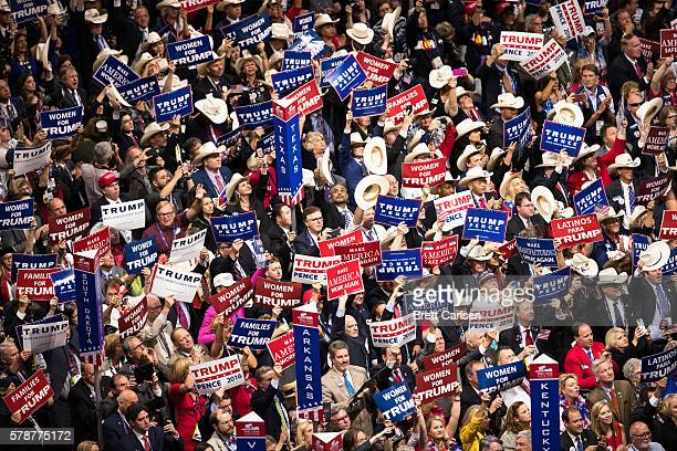 Delegates cheer as Donald Trump delivers his nomination acceptance speech on the final day of the Republican National Convention on July 21 2016 at...