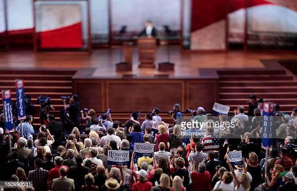 Delegates cheer as Representative Paul Ryan, Republican vice presidential candidate, speaks in this photo taken with a tilt shift lens at the...