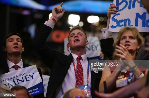Delegates cheer at the Republican National Convention in Tampa, Florida, U.S., on Wednesday, Aug. 29, 2012. Representative Paul Ryan takes the stage...