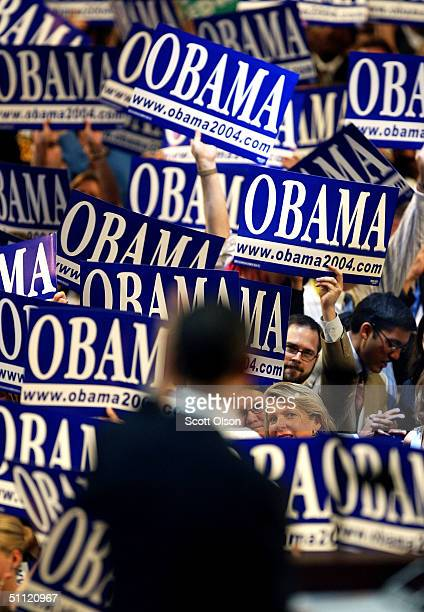 Delegates cheer during the keynote address by US Senate candidate Obama Barack of Illinois at the Democratic National Convention July 27 2004 in...