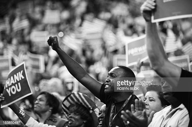 VERSION Delegates cheer for US President Barack Obama during his nomination acceptance speech at the Time Warner Cable Arena in Charlotte North...