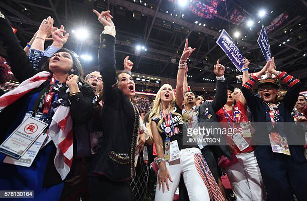TOPSHOT Delegates cheer on the floor of the Republican National Convention at Quicken Loans Arena in Cleveland Ohio on July 20 2016 The cost of the...