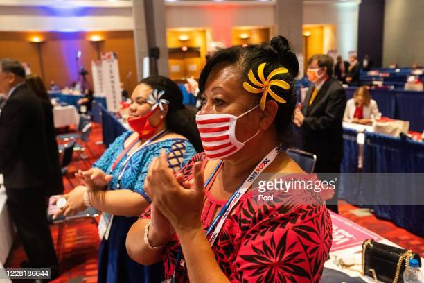 Delegates clap and listen as U.S. President Donald Trump speaks on the first day of the Republican National Convention at the Charlotte Convention...