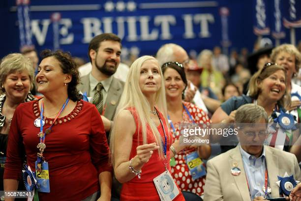 Delegates dance at the Republican National Convention in Tampa Florida US on Tuesday Aug 28 2012 Delegates are gathered in Tampa at the 40th...