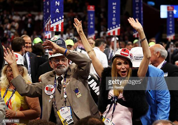 Delegates dance during the the evening session of the fourth day of the Republican National Convention on July 21 2016 at the Quicken Loans Arena in...