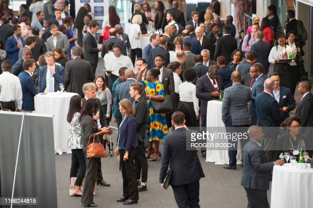 Delegates enjoy refreshments at end of the final day of the World Economic Forum Africa meeting at the Cape Town International Convention Centre, on...