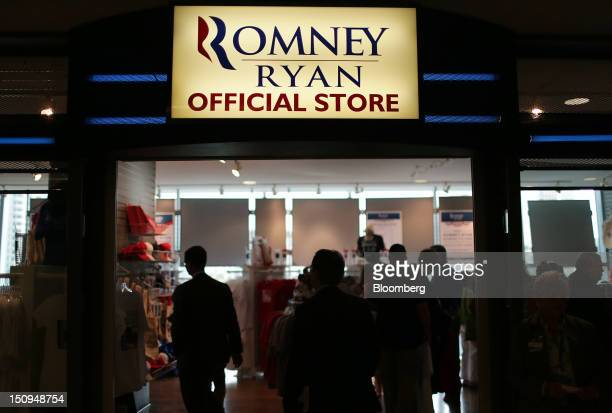 Delegates enter the RomneyRyan official store at the Republican National Convention in Tampa Florida US on Wednesday Aug 29 2012 Representative Paul...