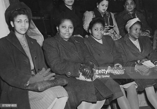 Delegates from all over the world at a meeting to celebrate International Women's Day Marie Campbell Miss Hazeley Miss Inyang and Miss Ikpeme London...