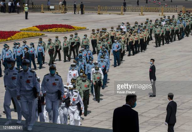 Delegates from China's military arrive at the closing session of the National People's Congress at the Great Hall of the People on May 28 2020 in...