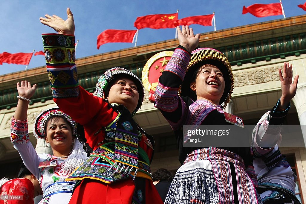 Delegates from Chinese ethnic minority groups arrive at the