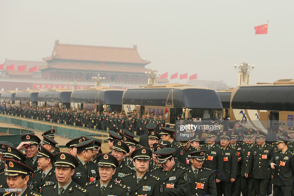 Delegates from Chinese People's Liberation Army march from Tiananmen Square to the Great Hall of the People to attend a plenary session of the National People's Congress during severe pollution on March 8, 2013 in Beijing, China. Clearing urban air pollution has become a big concern during the National People's Congress.