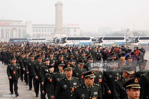 Delegates from Chinese People's Liberation Army march from Tiananmen Square to the Great Hall of the People to attend a plenary session of the...