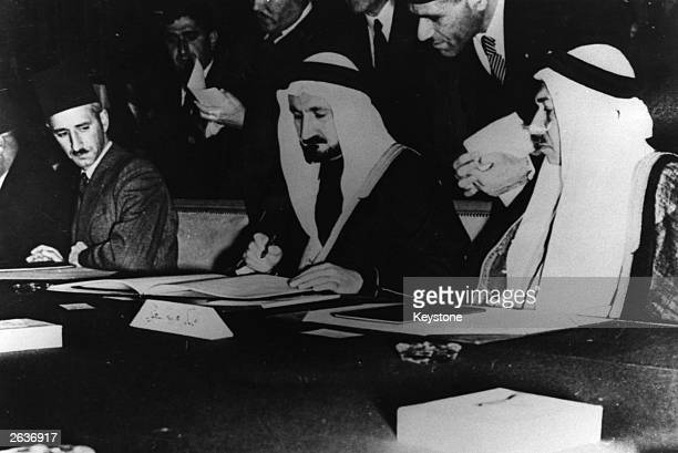 Delegates from Egypt Iraq Syria the Lebanon Saudi Arabia and TransJordan signing the Arab League Charter