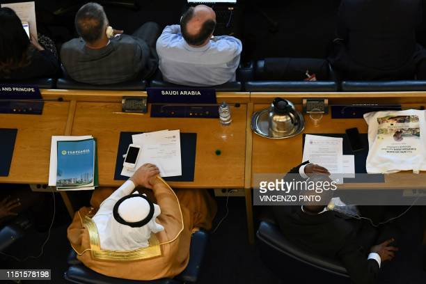 Delegates from Saudi Arabia attend a plenary session to elect the new DirectorGeneral of the Food and Agriculture Organization of the United Nations...