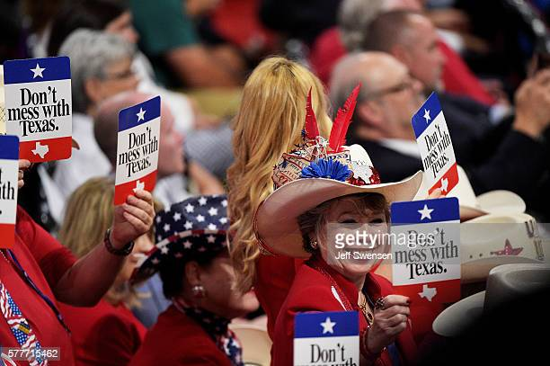 Delegates from Texas hold signs that read Don't mess with Texas on the second day of the Republican National Convention on July 19 2016 at the...
