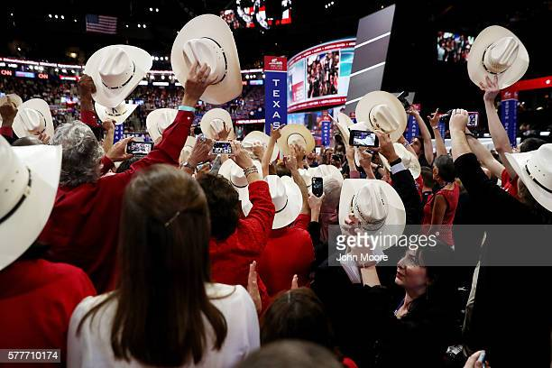 Delegates from Texas take part in the roll call in support of Sen Ted Cruz on the second day of the Republican National Convention on July 19 2016 at...