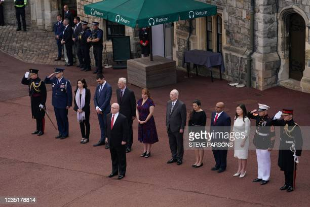 Delegates from the United States Embassy, including acting US Ambassador, Philip T Reeker, Charge d'Affaires, observe a minute's silence during the...