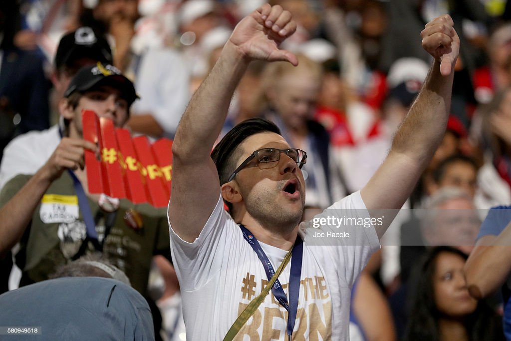 A delegates gestures while chanting during the opening of the first day of the Democratic National Convention at the Wells Fargo Center, July 25, 2016 in Philadelphia, Pennsylvania. An estimated 50,000 people are expected in Philadelphia, including hundreds of protesters and members of the media. The four-day Democratic National Convention kicked off July 25.