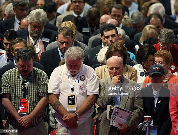 Delegates hold a prayer on day one of the Republican National Convention at the Xcel Energy Center September 1 2008 in St Paul Minnesota The GOP will...