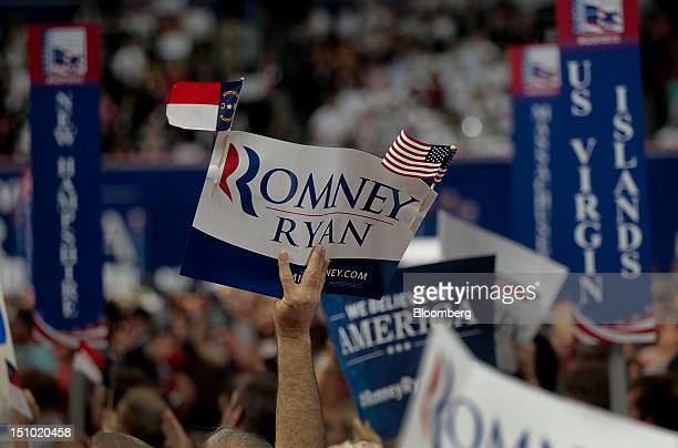 Delegates hold signs at the Republican National Convention in Tampa Florida US on Thursday Aug 30 2012 Republican presidential nominee Mitt Romney a...