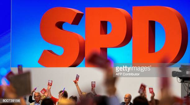 Delegates hold up their voting cards during a congress of Germany's social democratic SPD party in Dortmund, western Germany, on June 25, 2017. The...