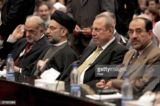 Delegates Ibrahim Jaffari Abd AlAziz Hakim Noori Shawes and Jawad AlMalki listen to speeches during the second session of the parliament on April 22...