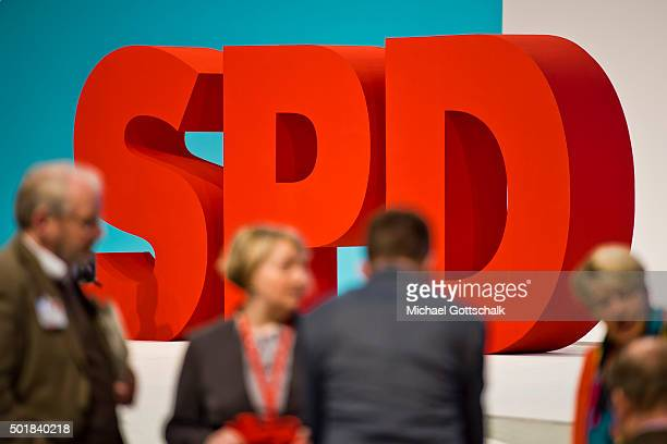 Delegates in front of SPD Logo at SPD party convention on December 12 2015 in Berlin Germany