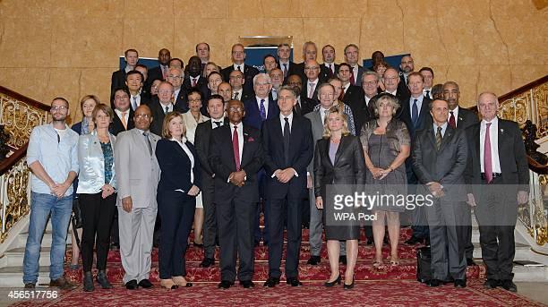 Delegates including British Foreign Secretary Philip Hammond British Secretary of State for International Development Justine Greening Sierra Leone's...